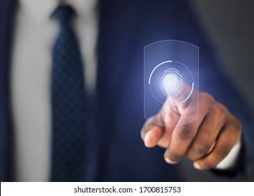 Biometric Authentification. Unrecognizable Businessman Scanning Fingerprint On Virtual Panel For Access. Cropped, Closeup, Selective Focus