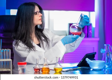 Biometric diagnostics. A female expert checks the density of the chemical solution. The study of the biomaterial. DNA analysis. Forensic medical examination. DNA check.