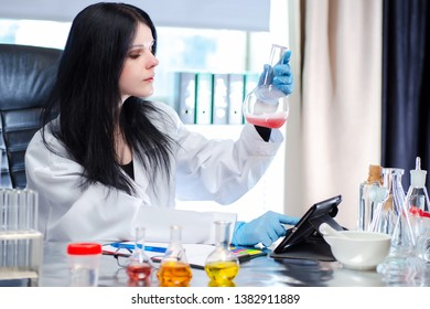 Biometric diagnostics. A female expert looks at the precipitate in a chemical solution. The study of the biomaterial. DNA analysis. Forensic medical examination. DNA check.