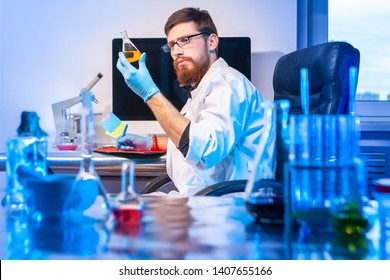 Biometric diagnostics. A male expert checks the density of the chemical solution. The study of the biomaterial. DNA analysis. Forensic medical examination. DNA check.