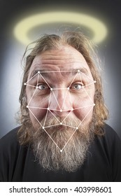 Biometric verification - facial recognition of a bearded man with nimbus on his head