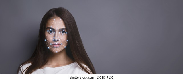 Biometric verification. Facial recognition of young woman via polygon mask on face, panorama with copy space