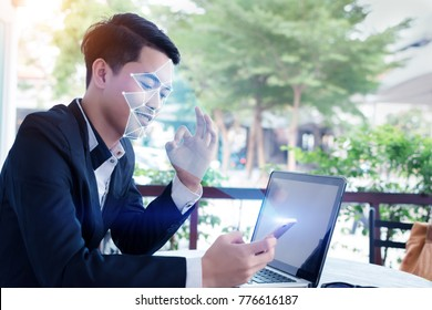Biometric verification.Businessman is using face recognition system of smartphone with hand ok.Data Protection.Advanced technology.Artificial intelligence(AI).IT security.