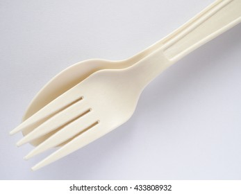 bioplastic spoon and fork on white background