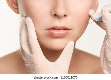 Biorevitalization cosmetology injection. Face skin treatment. Beauty facial filling. Filler botulinum.