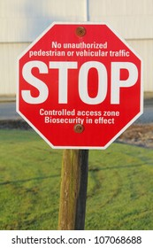 A bio-security sign warns visitors not to proceed/Biosecurity Stop Sign/A sign alerts visitors that the farm is a biosecurity zone.