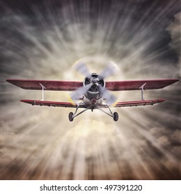 biplane against the sun on the vintage background