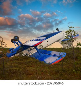 Biplane had crashed in marsh due to engine failure. Plane had rotation after emergency landing on the marsh. It lay up landing gear.