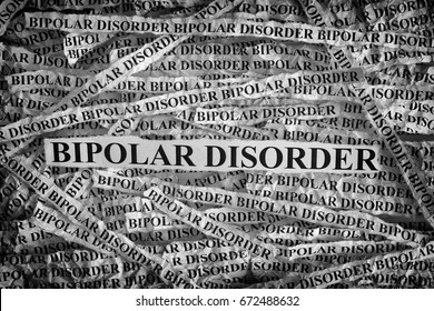 Bipolar Disorder. Torn pieces of paper with the words Bipolar Disorder. Concept Image. Black and White. Closeup.