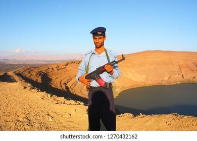 BIR ALI, YEMEN - DECEMBER 2008: unidentified man who escorts tourists in Yemen on December 26, 2008 at Bir Ali crater in Balhaf