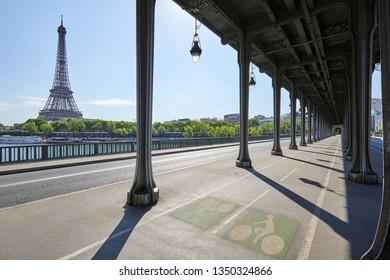 Bir Hakeim bridge and Eiffel tower in a sunny summer day, nobody in Paris, France