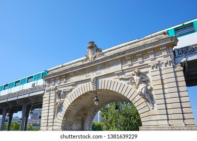 Bir Hakeim bridge and metro train passing in a sunny summer day in Paris, France