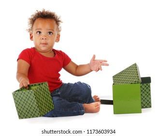 A biracial baby holding an empty gift box, as if to ask the viewer to fill it.  On a white background.