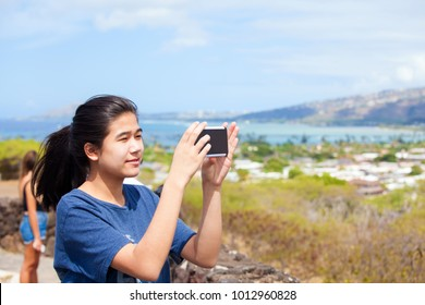 Hawaiian teen girl selfie spending