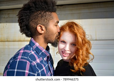 biracial couple smiling and happy and in love
