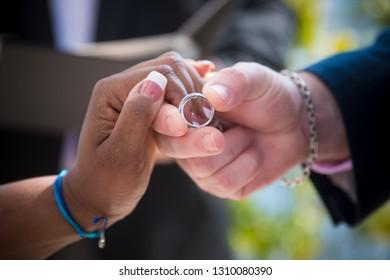 biracial couples exchange wedding rings