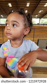 Biracial toddler at the arena having a snack