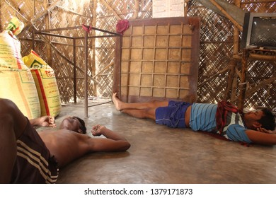 Birbhum, West Bengal/INDIA - April 22, 2019: Some Indian poor tribal and  work less people sleeping on the floor
