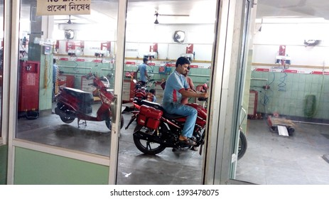 Birbhum, West Bengal/INDIA - May 10,2019: Some Indian motorcycle mecanic repairing some motorcycle in the motorcycle garage