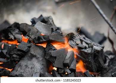 The birch coals burn with a bright flame