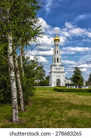 Birch grove and church in Russian village