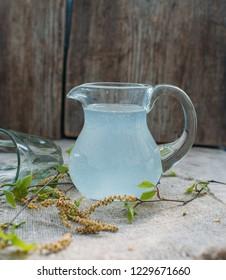 Birch juice in jar/toned photo