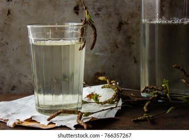 Birch natural juice detox in a glass . Rusty metal