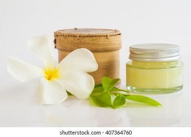Birch-bark cosmetic box and cosmetic cream isolated on white. Pretty design.
