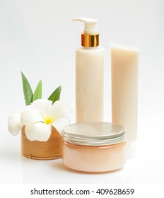Birch-bark cosmetic box and cosmetic cream isolated on white with frangipani  flower