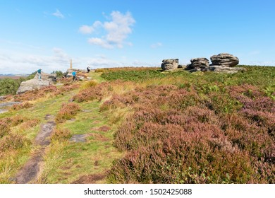 Birchen Edge, Derbyshire, is popular with walkers and climbers on bright summer days.