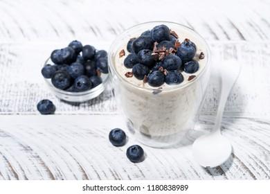 bircher muesli with fresh blueberries, top view horizontal