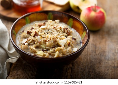 Bircher muesli, or oatmeal porridge with apple, fruit and nut