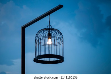 Bird cage decorated as light post. Idea concept.