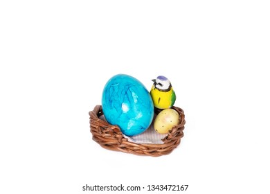 Bird and colorful eggs in Easter basket