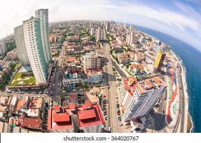 Bird eye aerial view of Havana city capital of Cuba in latina america - Detail of skyscrapers in modern downtown business district - Skyline with fisheye lens distortion and warm saturated color tones