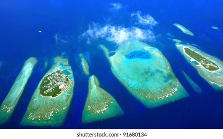 Bird eye view of atolls from Maldives .