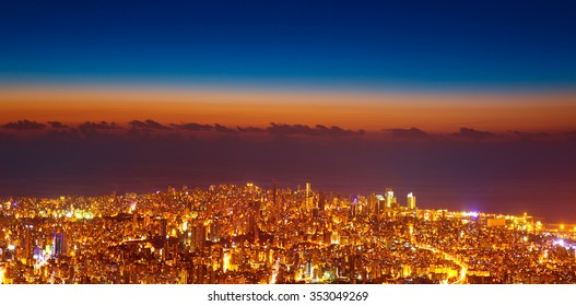 Bird eye view of beautiful night cityscape, many glowing lights in nighttime in Lebanon, picturesque scene, travel and tourism concept