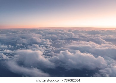 Bird eye view of clouds. Shot from airplane window.