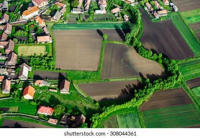 Bird Eye View of the Countryside with Village and Fields of Crops. Aerial Views.