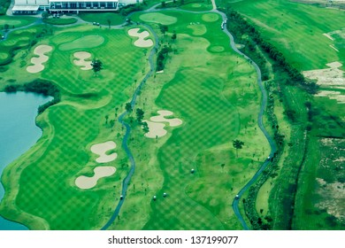 Bird eye view from private air craft, view of Bangkok crowded city the view of golf yard