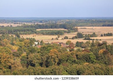 Bird eye view of small town, farmlands and forests in Poland