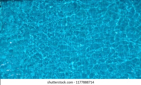 Bird eyes view images of hotel swimming pool salt system not clorine which have blue clear color water and good for health and relaxing in summer vacation day on Bangkok Thailand