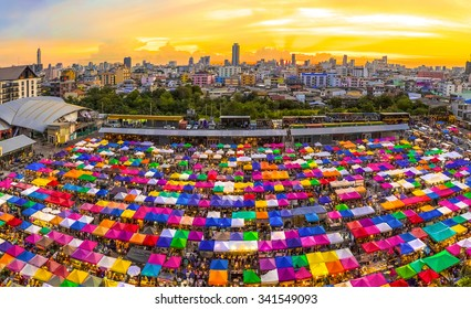 Bird eyes view of Multi-colored tents /Sales of second-hand market at twilight - Panorama picture