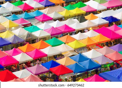 Bird eyes view of Multi-colored tents /Sales of second-hand market at twilight.