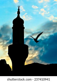 bird flying near mosque tower