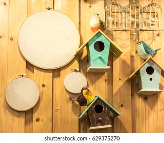 BIrd hosue and board with wood background