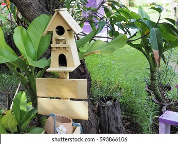 bird house in a green garden.Bird houses made of wood,garden decorations.