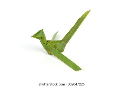 bird made of coconut leaves on white background