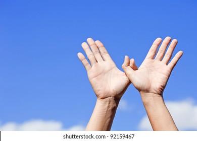 Bird made of hands over the blue sky