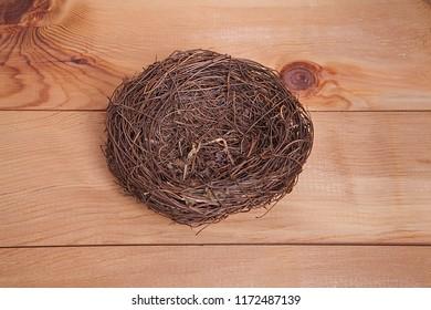 bird nest on wooden background.